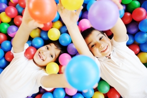 kids in colored balls