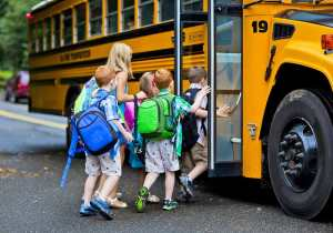 kids-getting-on-the-school-bus-small-2