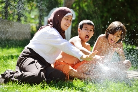 Kids in Sprinkler