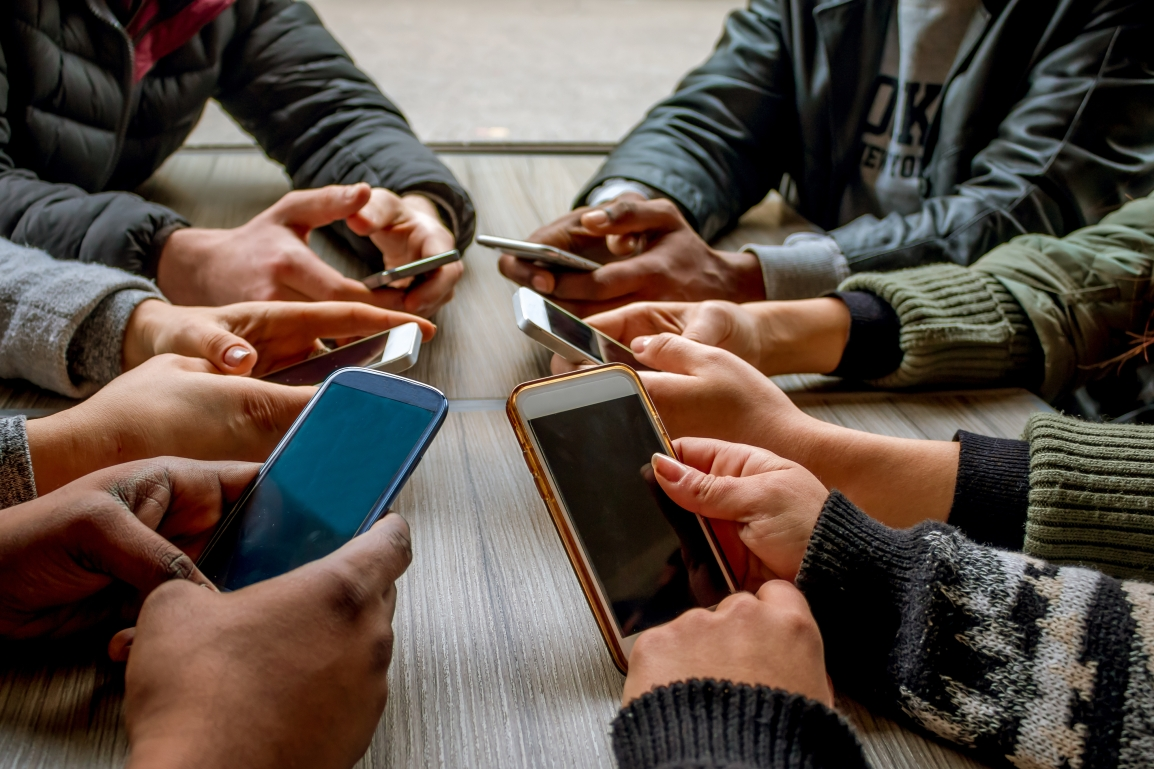 Group - Holding Phones.jpg